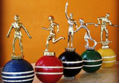 DIY trophies mounted on croquet balls -- handmade and vintage goods
