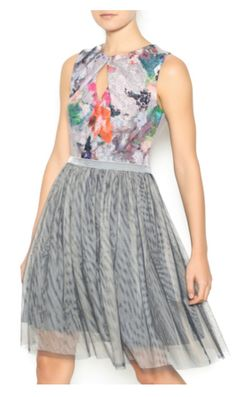 Grey dress with a floral printed top, full tulle skirt and a back zipper closure.   http://shoptiq.it/1NSDRJU