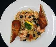 Try our Shrimp Scampi at Grille One Eleven... Sautéed shrimp in a white wine roasted garlic butter with black olives and grape tomatoes over linguine.
