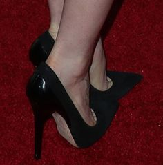 Lily Collins shows off her feet in black Jimmy Choo pumps