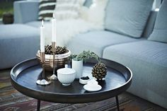 Decoration on a small table, including the small Lyngby vase, some candlelights and bowls.