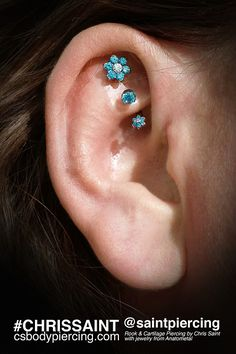 Rook and Cartilage piercing with jewelry from anatometal. Ooh, I like the flower. Faux Rook Piercing, Piercing Tattoo, Body Piercing, Rook Jewelry, Helix Jewelry, Jewellery, Different Ear Piercings, Cool Ear Piercings, Body Art Tattoos