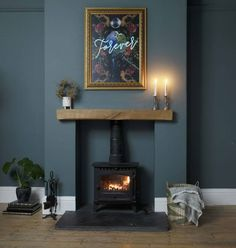 Blue El neon wire in a gold guilt frame Navy Living Rooms, Living Tv, Living Room Grey, Home Living Room, Living Room Designs, Cosy Cottage Living Room, Blue And Gold Living Room, Log Burner Living Room, Living Room Decor Fireplace