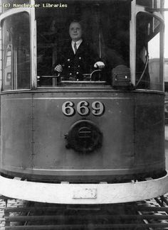 Britain's first woman tram driver, Manchester, England, United Kingdom, 1944, photograph by G. R. Hinks.