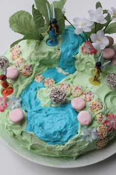 Messy, but all the ideas on here are great, multi tiered, plastic plants, light colors! Fairy garden cake