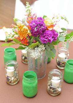 Use Mason Jars to Decorate Tables at a Reception.