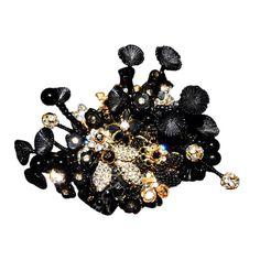 Stanley Hagler Black Beads & Rhinestone 3D Brooch  USA  1980  Stanley Hagler avante garde mini garden patch brooch. A mix of flowers, leaves and stemmed pieces. Black, gold and rhinestone clear crystals.