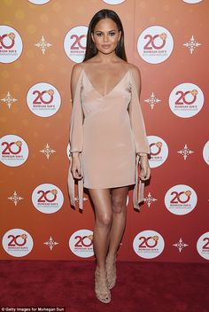Queen of hearts: Teigen showed off her sexy elegance on the red carpet of the casino event...