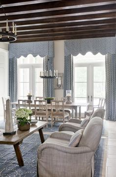 Little bit taller coffee table.  Custom valances above French doors.  Constrained palette - blue, off-white Flatweave rugs on stone floors Mrs. Howard.