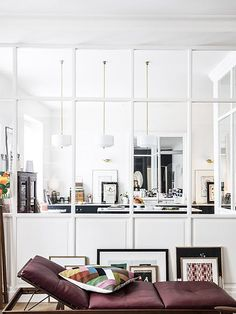 white walls and pendant lamps in home of Morgane Sézalory, Sézanefashion boutique founder. / sfgirlbybay