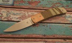 Liner Lock Folder with Bohler N690 blade, Mokumi bolsters and Serpentine handle.
