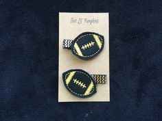 This football feltie hair clip is the perfect addition to any girls football outfit! The feltie comes securely attached to a partially lined 1 3/4 inch single prong alligator clip lined with chevron grosgrain ribbon. Please select whether you want a set of two or whether you want one clip (left or right side) when ordering. All hair clips are handmade with love by me in my smoke and pet free home. Please convo me if you have any questions. Thanks!  *As with any small hair accessory, plea...