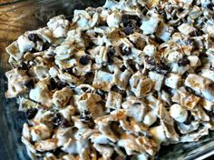 Golden Graham S'more Bars  Ingredients: 1 16 oz. bag mini marshmallows (the bigger bag) 1/2 a 12 oz. package semi sweet chocolate chips 7 tb...