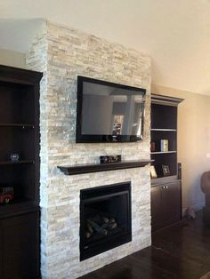Elite tv above brick fireplace ideas for 2019 Kitchen Fireplace, Home Fireplace, Stacked Stone Fireplaces, Fireplace Design, New Homes, Fireplace Remodel, Family Room Remodel, Basement Fireplace, Fireplace Hearth