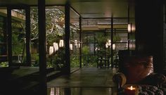 """The dreamlike zen aviary at the centre of the house is complete with exotic greenery, extensive fishponds and soothing water features, from the movie """"when a stranger calls"""""""