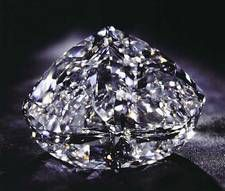 The Centenary Diamond is the third largest diamond to have been extracted from the DeBeers mine in South Africa. Its 273.85 carats is internally and externally flawless with a D color rating. It was displayed in its uncut form at 599 carats for the DeBeers Centenary Anniversary.