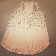 Cheetah tank top Cream colored cheetah print tank top from Converse. Worn only once! In excellent condition. Tops Tank Tops