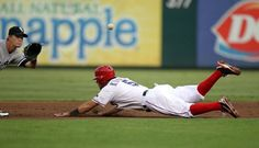 ARLINGTON, TX - JULY 27: Ian Kinsler #5 of the Texas Rangers is safe after stealing 2nd base against Gordon Beckham #15 of the Chicago White Sox on July 27, 2012 at the Rangers Ballpark in Arlington in Arlington, Texas. (Photo by Layne Murdoch/Getty Images)  game 98