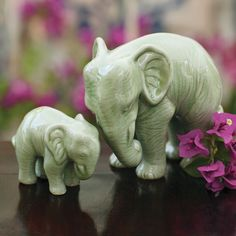 """Celadon Elephants/2set   NatGeoStore   """"...ceramics in Thailand since 9th century , celadon stoneware Thai art since 13th century. the Chinese brot to Siam. Thai culture revere elephants as powerful,  great wisdom.  Popular superstition says»it's good luck to walk underneath an elephant's belly."""