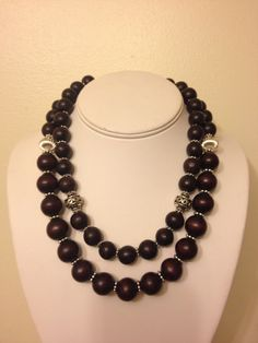 2-strand necklace using brown wood beads with silver accents.
