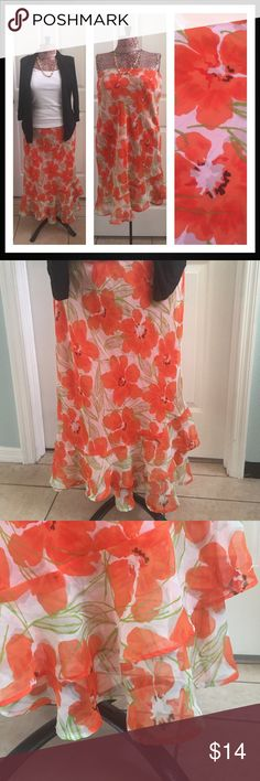 Cato maxi skirt Cato, Sz S, gorgeous maxi skirt, light and flowy with a beautiful large orange floral print. Uneven looking bottom ruffles add lots of character to this skirt. 34in in length, 💯% polyester. Couple loose stitches in waistband, as seen in pic, doesn't effect skirt. Cato Skirts Maxi