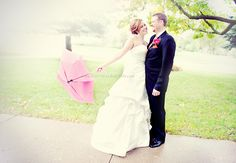 UMBRELLA! I love umbrellas in photos. I am probably going to need to do one at my wedding even if it's not raining.   (amanda basteen)