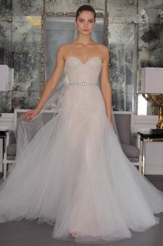 Romona Keveza 2016 wedding dress with sweetheart neckline and beaded belt, lace and beaded bodice with flowing tulle skirt and train   https://www.theknot.com/content/romona-keveza-wedding-dresses-bridal-fashion-week-2016