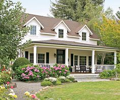 Triple Gabled Dormer Windows White house with stone porch steps