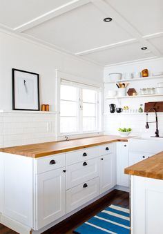 dark wood floors, white cabs, ORB handles, ORB faucet with white sink; Ikea Numerar Countertop - Cottage - kitchen - Smitten Studio