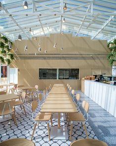 Four O Nine transforms greenhouse into plant-lined coffee shop
