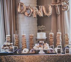 Elegantly unique wedding cake donut dessert display; Featured Photographer: Enderes Photography