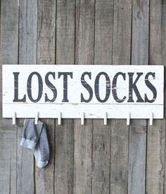 Don't let the dryer win, keep tabs on your lost socks with this charmingly rustic plaque. It has pins for up to 7 single socks for a sure shot at making a match.