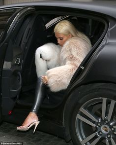 Making an arrival: Kim was seen carefully making her way out of her chauffeur-driven vehicle