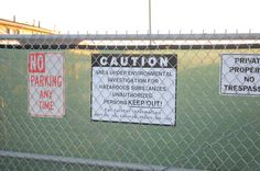 warning signs posted along the fences