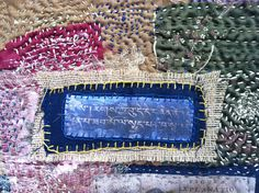 "Sanskrit Blue Heart Sutra by Natalie Turner-Jones. 21"" x 17"".  Layered textiles, batting, embroidery floss."
