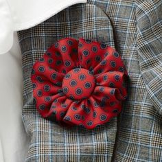 Turn old neckties into a beautiful brooch or boutonniere with this easy tutorial.
