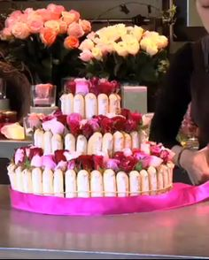 incredible rose-covered gâteau would be a stunning centerpiece for your magical fête.