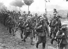 German infantry marches into Czechoslovakia, 1938. Note the troops wearing WW1-era steel helmets still carrying the Reichswehr decal The Reichswehr was Germany's defense force from 1919 until 1935, when Hitler declared full rearmament.