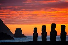 """Sunrise at the """"famous 15"""" on Isla de Pascua (Easter Island) Chile. Ahu Tongariki is one of the most incredible sights in the world especially during the early morning glow of a beautiful sunrise. // photo by @jonathan_irish by natgeotravel"""