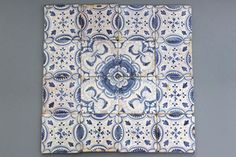A set of 16 English Delft blue and white ornamental tiles, 1