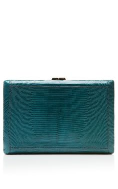 This VBH clutch features lizard exterior, tonal hardware top snap closure and rectangle compact shape. BlueLizardMade in ItalyPlease note: This item is returnable for credit or full refund.