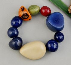 Chunky bracelet with big navy blue tagua nuts, bold elastic vegetable ivory bracelet with multicolor beads, colorful big bracelet by ColorLatinoJewelry on Etsy Fair Trade Jewelry, Cardboard Jewelry Boxes, Bangles, Beaded Bracelets, Tribal Jewelry, Handcrafted Jewelry, Navy Blue, Etsy Shop, Unique