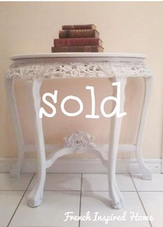 """FRENCH INSPIRED HALL CONSOLE TABLE     $175  Timeless Elegance.  This beautiful half moon hall console table is reminiscent of times gone by.  It's a classic piece that showcases carved wood artistry and has been reimagined in shades of white and lightly distressed for a lovely monochromatic look.  Nice scale and proportions.  A lovely, vintage piece that combines inspired design and value.   30 ½"""" wide at the back, 14 ¾"""" deep at the centre point and 28 ¾"""" high.  2 pieces. Hall Console Table, French Provincial Furniture, Shades Of White, Timeless Elegance, Inspired Homes, Entryway Tables, Carving, Design Inspiration, Carved Wood"""