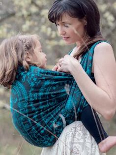Shown in an effervescent blue against a black backdrop, intended to represent the magical moment when the Sindarin word for 'Friend' (Mellon) is spoken by Words With Friends, Baby Sling, Baby Wraps, Snug Fit, Mom, Hair Styles, Thumbnail Image, Blue, Shopping