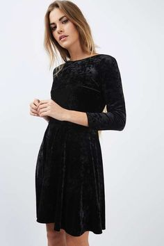 Opt for the skater silhouette for a flattering style. This dress comes in a luxe black velvet, with a low back, mini fit and 3/4 sleeves. Suitable for both day and night, we've teamed with a pair of over-the-knee boots to keep the look sleek. #Topshop
