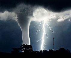 A tornado and lightning at night.