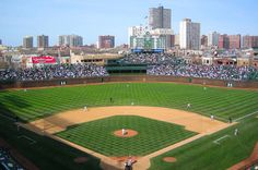 watch a baseball game at wrigley field.