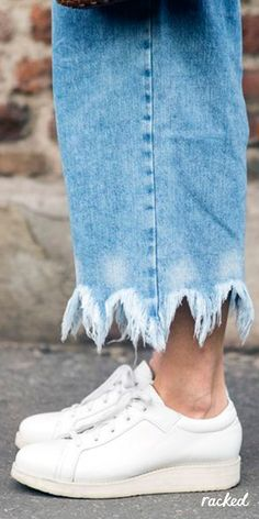 Frayed Hem Jeans, Worn With Classic, Simple White Sneakers at Milan Fashion Week // More Winter Style Ideas from the Best MFW Fall 2016 Street Style: (http://www.racked.com/2016/2/25/11112352/mfw-fall-2016-street-style)