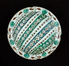 An Iznik pottery Dish with vertical floral bands Turkey, 17th Century (290)