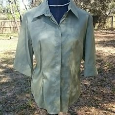 """Green Express blouse Cute pale green polyester / nylon /spandex blend button down blouse by Express. Has 3/4"""" sleeves. Material wears well. Has a nice stretch and crisp feel. Express Tops Blouses"""